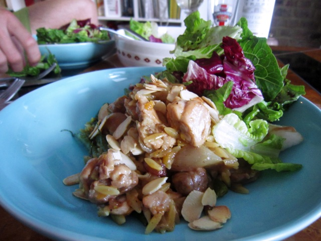 ... almonds scattered all over the top of the dish and a sharp green salad